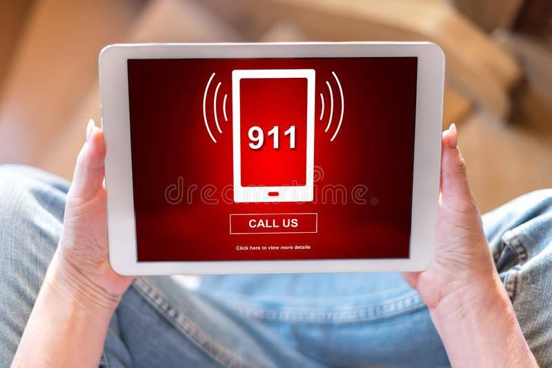 Emergency concept on a tablet. Tablet screen displaying an emergency concept royalty free stock photo