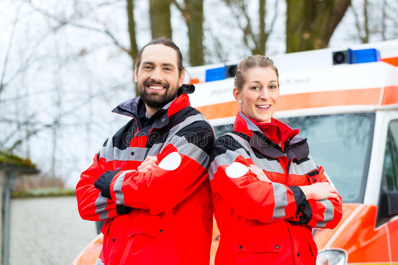 Emergency doctor in front of ambulance car stock photography