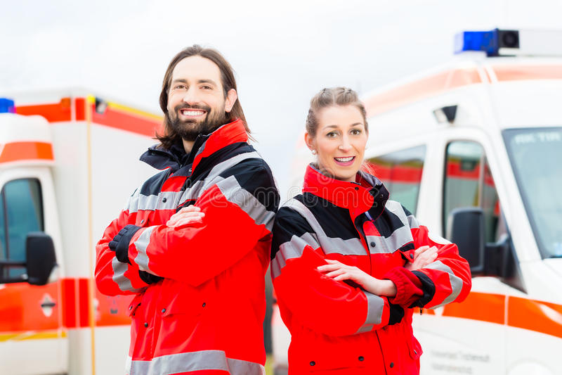 Emergency doctor and paramedic with ambulance stock photography