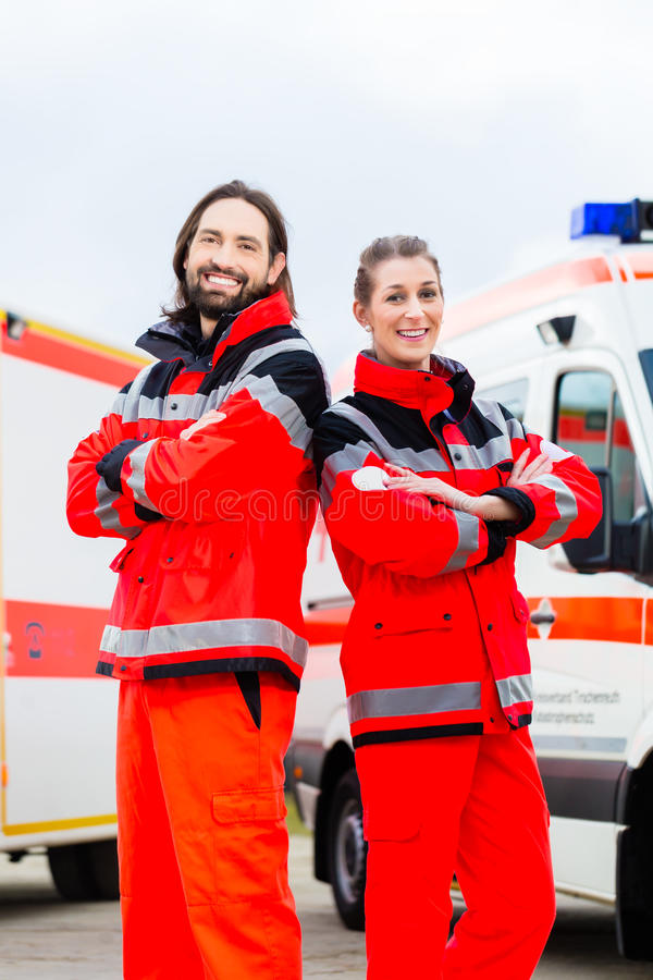 Emergency doctor and paramedic with ambulance royalty free stock photography