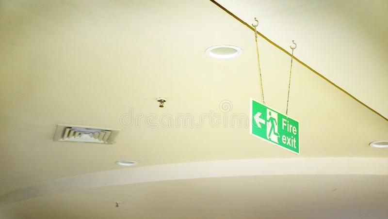 Emergency exit,fire alarm,Fire exit sign and in the blurred background Fire Sprinkler Life Safety. Emergency exit,fire alarm,Fire exit sign and in the blurred stock photo