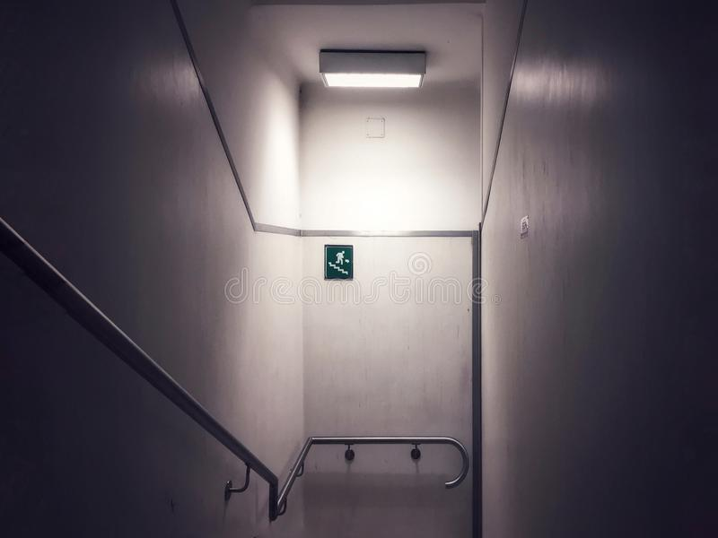 Emergency exit sign. On a staircase stock photography