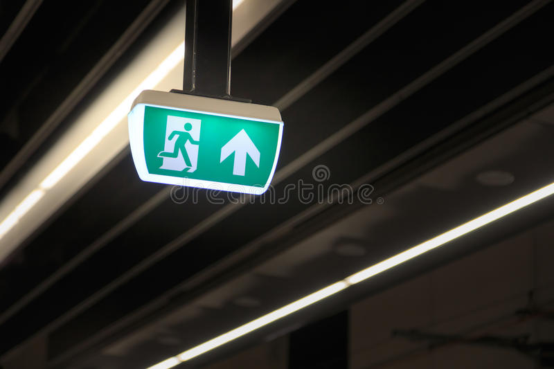 Emergency exit. Sign under fluorescent lighting royalty free stock photography