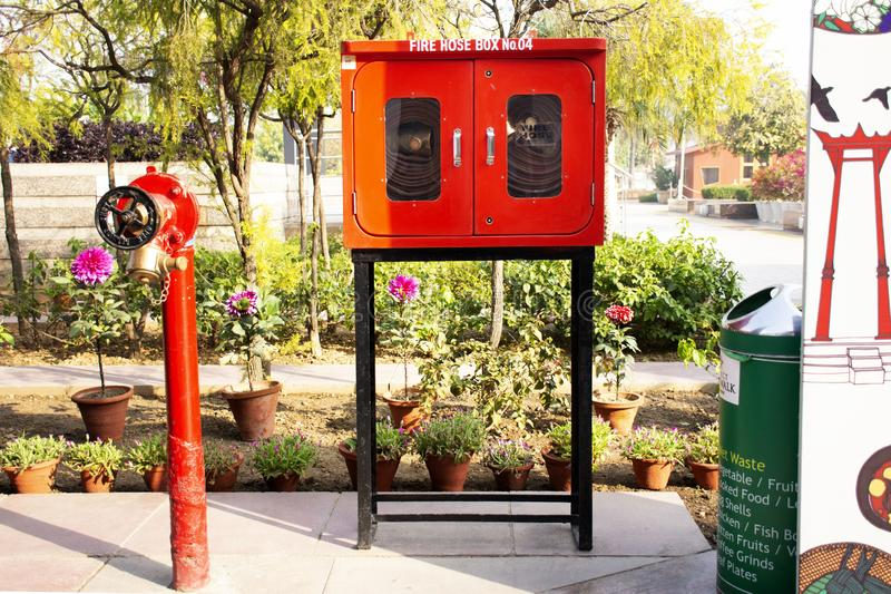 Emergency fire equipment station for firefighter and caution label patio park garden of Department store while at thai festival. On March 15, 2019 in New Delhi stock photography