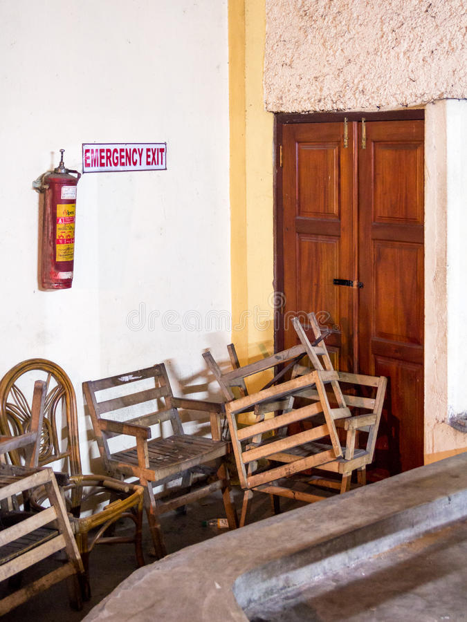 Emergency fire exit of a theather in Kandy, Sri Lanka, blocked b. Y chairs stock photography