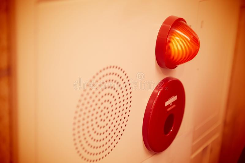 Emergency light wall panel and alarm speaker sound. In the office building royalty free stock photography