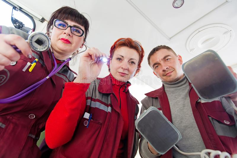 Emergency medical services workers providing first aid to patient royalty free stock image