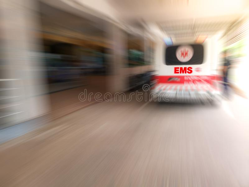 Emergency medical staff team transporting patient to hospital with ambulance into an Accident & Emergency ward of a hospital. EMS. royalty free stock photography
