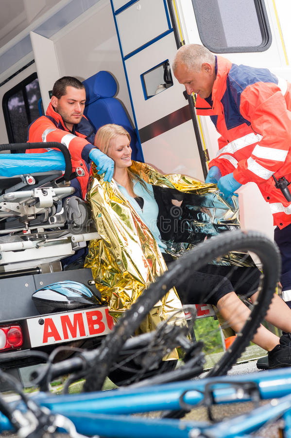 Emergency Paramedics Helping Woman Bike Accident Stock Photography