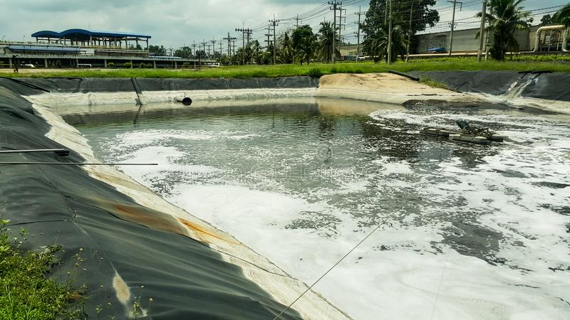 Emergency pond for water effluent treatment royalty free stock image
