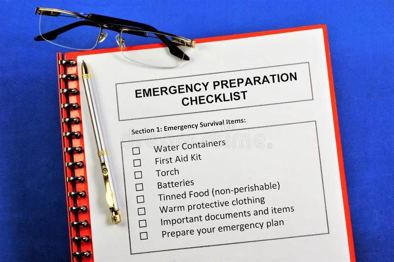 Emergency preparedness checklist.Emergency survival items.Water containers, first aid kit, torch, batteries, canned food, warm. Protective clothing, important royalty free stock images