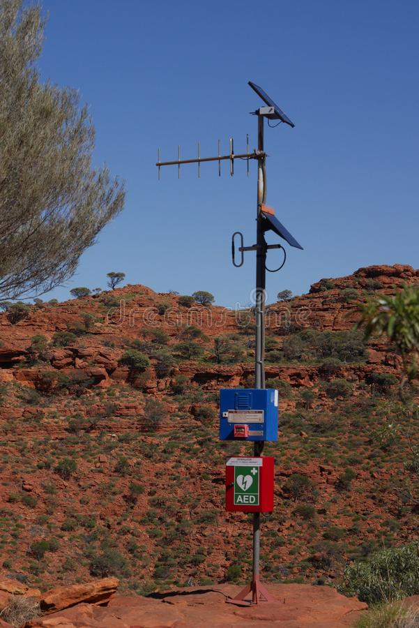 Emergency radio post. Emergency radio station with an AED in Kings Canyon in Australian outback stock photography