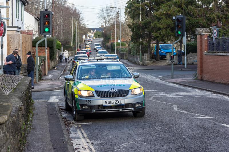 Emergency rapid response vehicle parked next to traffic lights stock photography