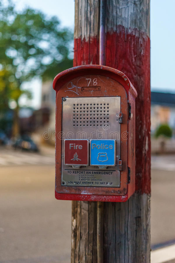 Emergency Reporting System box to notify the police and fire department n old wooden pole. Emergency Reporting System box to notify the police and fire royalty free stock photography