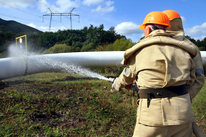 Emergency response exercise employee gas compressor station in C royalty free stock photo