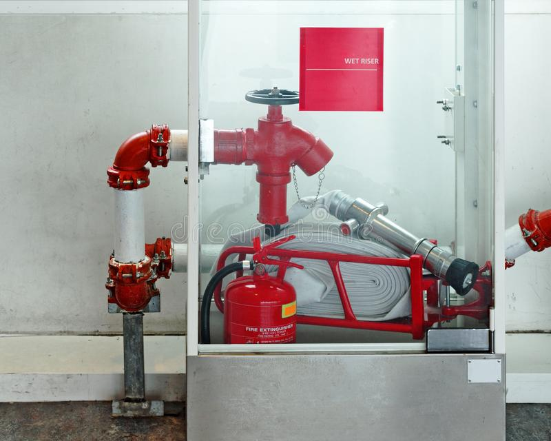 Emergency security kit - fire hydrant, water supply valve, fire extinguisher in a glass box stock image