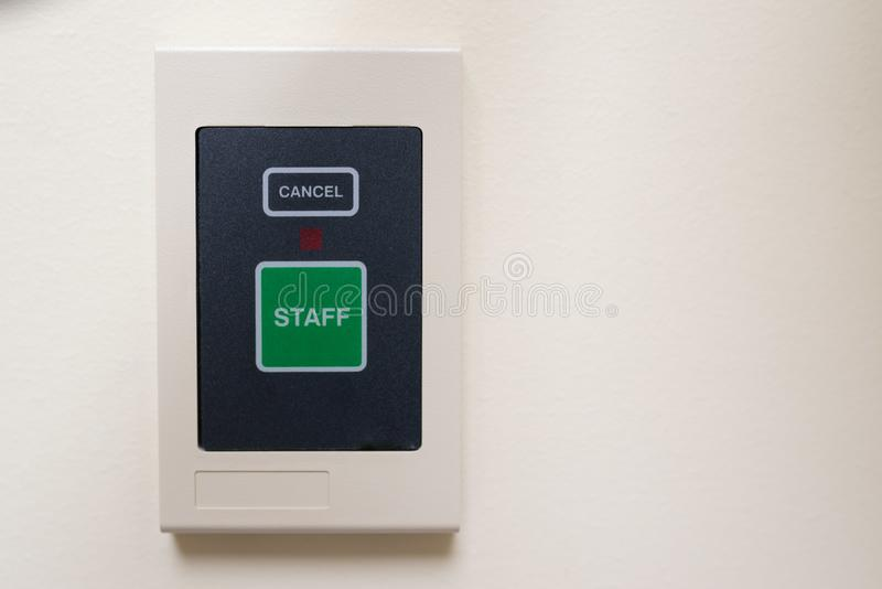 Emergency staff call button on the wall royalty free stock image