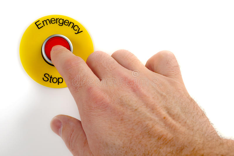 Emergency Stop. Person pushing emergency stop switch on white royalty free stock photos