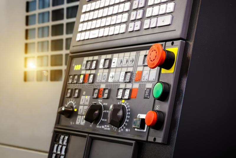 Emergency stop button depth of field, focus blur in CNC machine control panel with machining machine and late process stock image