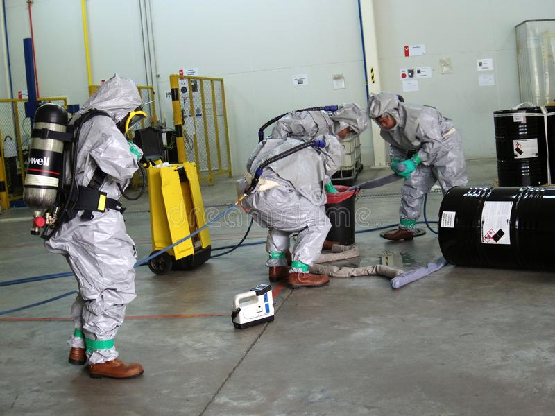 Emergency team wearing chemical protection suit for work in dang stock photos