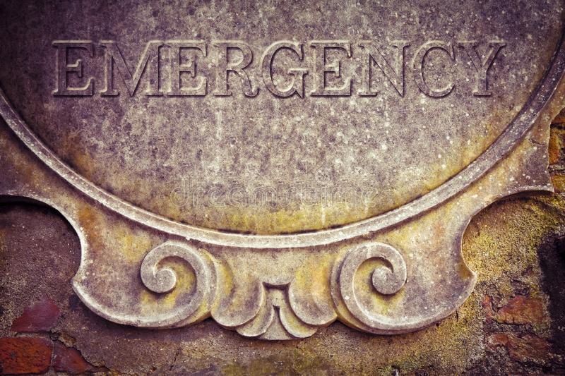 Emergency text written on stucco wall - concept image.  royalty free illustration