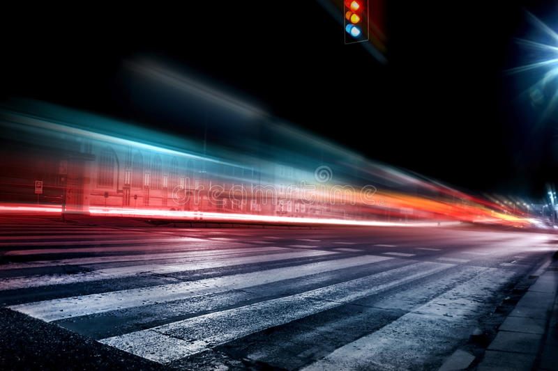 Emergency vehicle. Blurry car lights in a night scene of the city stock photo
