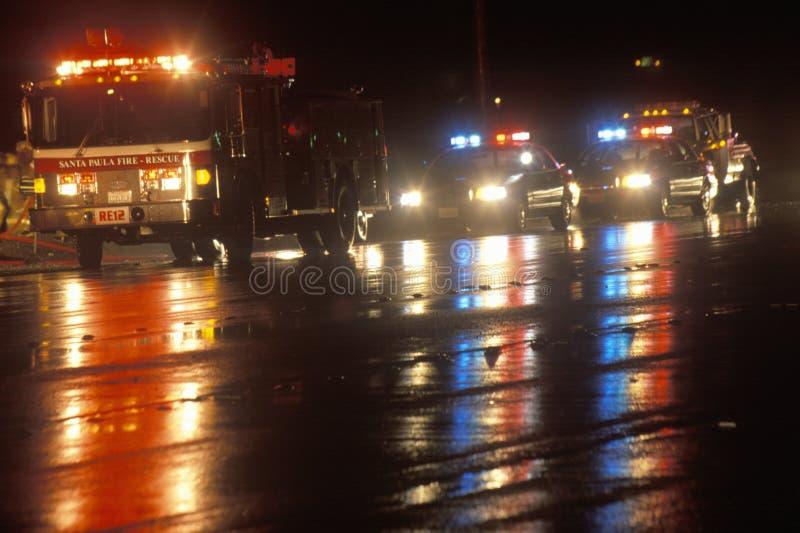 Emergency vehicles on a rainy night, Santa Paula, California stock image