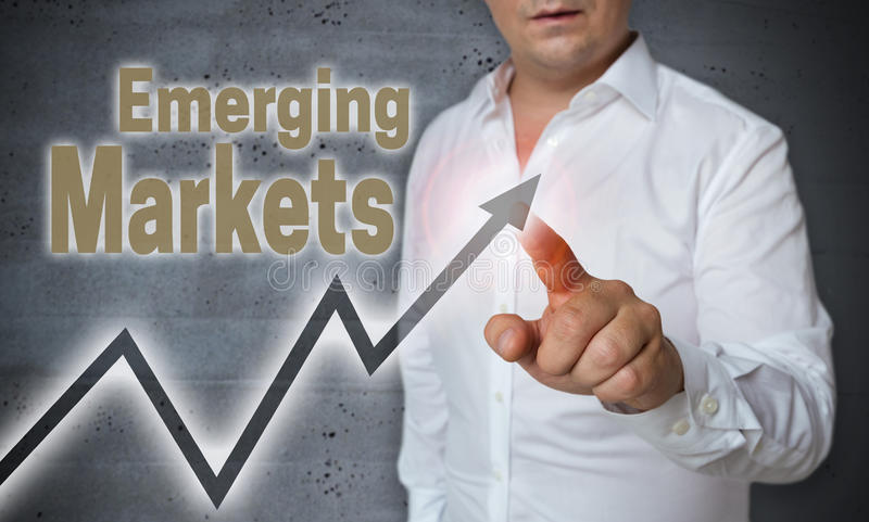 Emerging Markets touchscreen is operated by trader royalty free stock photos