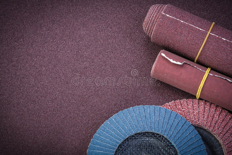 Emery paper flap grinding wheels on polishing sheet copy space.  stock image