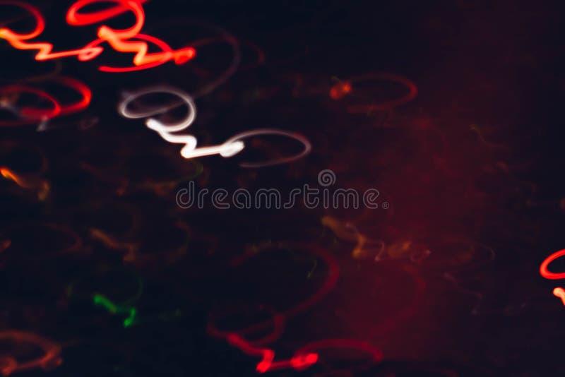 Emettendo luce swirly linee multicolori al neon firma fotografia stock