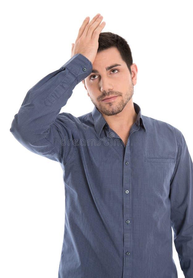 Emicrania: giovane responsabile con l'emicrania in camicia blu isolata sopra fotografia stock libera da diritti
