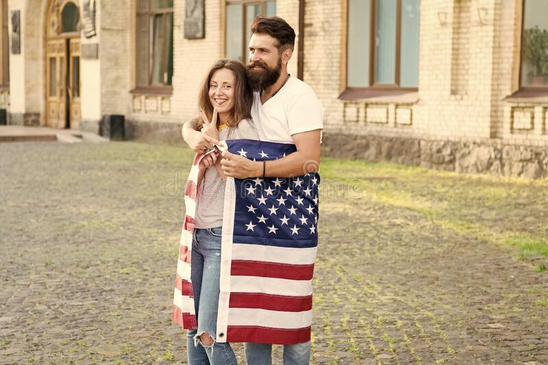 Emigration from the native country. Happy couple of emigrants on independence day of the us. Emigration for better royalty free stock image