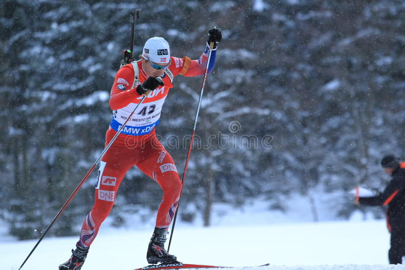 Emil Hegle Svendsen - biathlon world cup. Climbing Emil Hegle Svendsen from Norway in women 12,5 km pursuit race within biathlon world cup 2014/2015 held on Nove royalty free stock photo