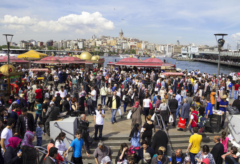Eminonu. Crowd in Eminonu District. Eminonu Square, people eating fish. Eminonu Square is so crowded on day.People watching golden horn stock photo