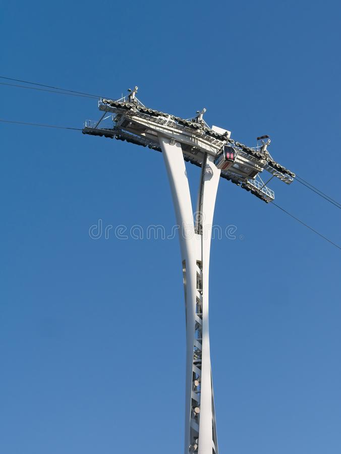 Emirates Air Line Cable Car passing through the column stock photography