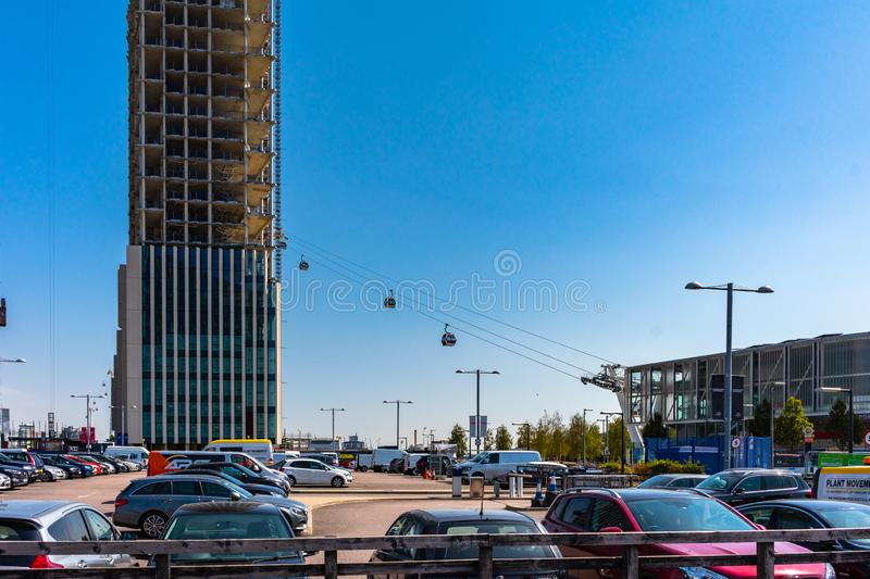 Emirates Air Line cable cars on thames river in London, UK royalty free stock photos