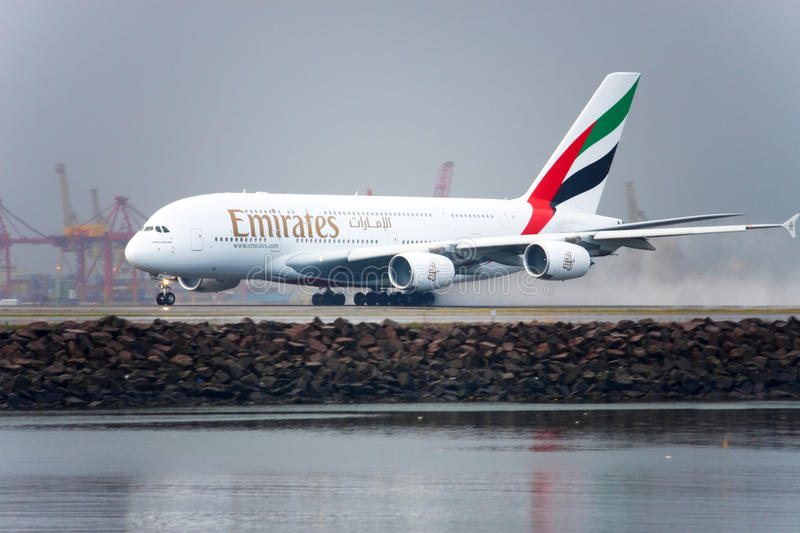 Emirates Airbus A380 takes off in the rain. royalty free stock photography