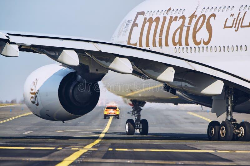 Emirates Airbus A380 follow aircraft marshaller stock photo
