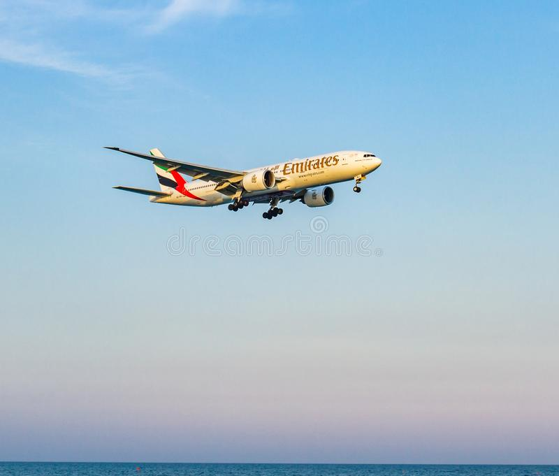 Emirates Airline Boeing 777 above the sea moments before landing. Larnaca, Cyprus - April 29, 2018: Emirates Airline Boeing 777 above the sea moments before stock photography