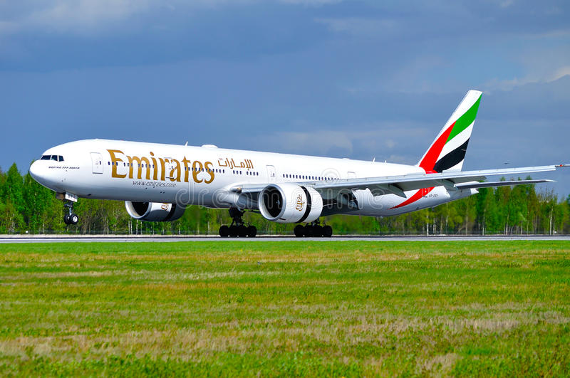 Emirates Airline Boeing 777 aircraft is landing in Pulkovo International airport in Saint-Petersburg, Russia. SAINT PETERSBURG, RUSSIA - MAY 11, 2016. Emirates royalty free stock photos