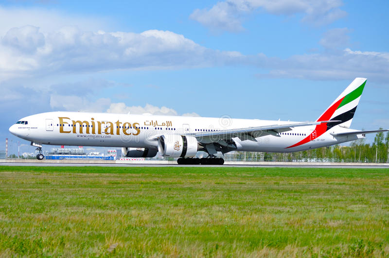 Emirates Airline Boeing 777 aircraft is landing in Pulkovo International airport in Saint-Petersburg, Russia. SAINT PETERSBURG,RUSSIA-MAY 11,2016.A6-EBY Emirates royalty free stock image
