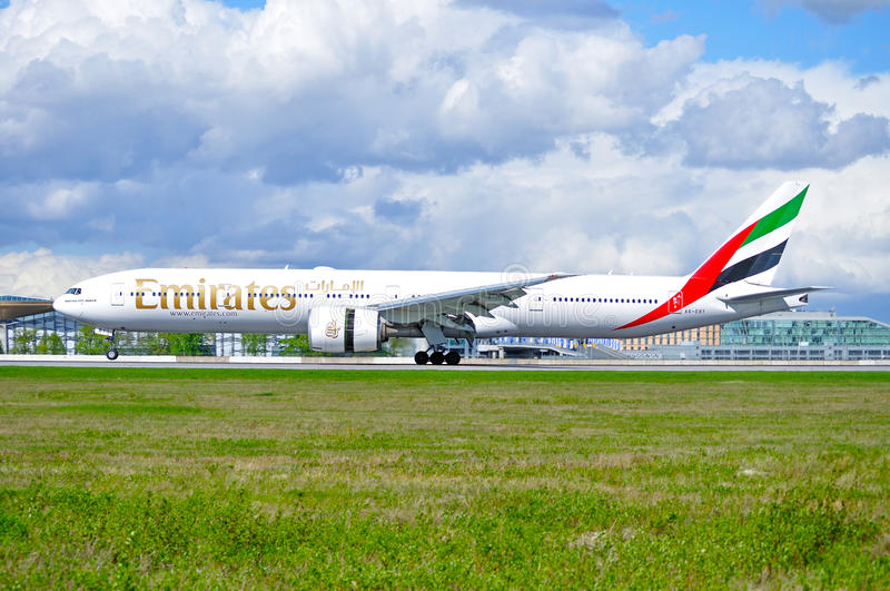 Emirates Airline Boeing 777 aircraft is landing in Pulkovo International airport in Saint-Petersburg, Russia. SAINT PETERSBURG,RUSSIA-MAY 11,2016.A6-EBY Emirates stock images
