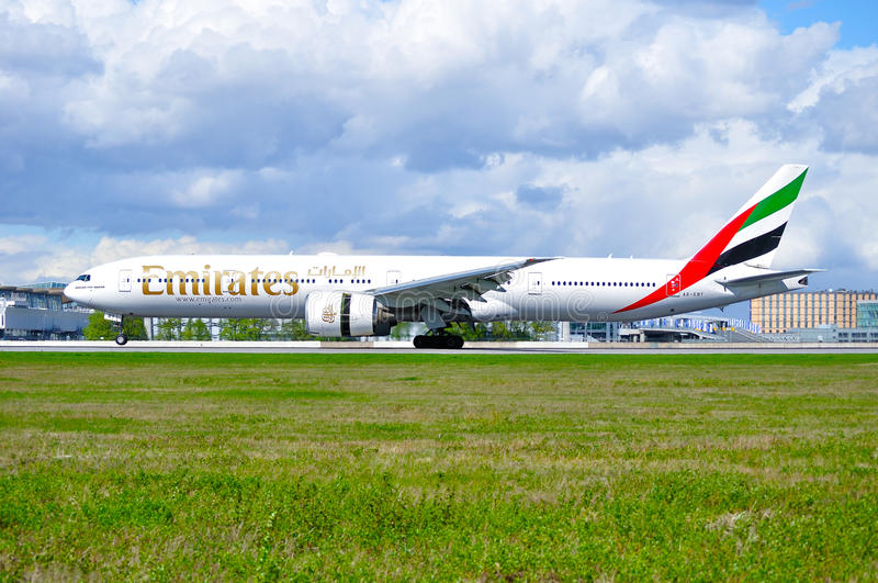 Emirates Airline Boeing 777 aircraft is landing in Pulkovo International airport in Saint-Petersburg, Russia stock images
