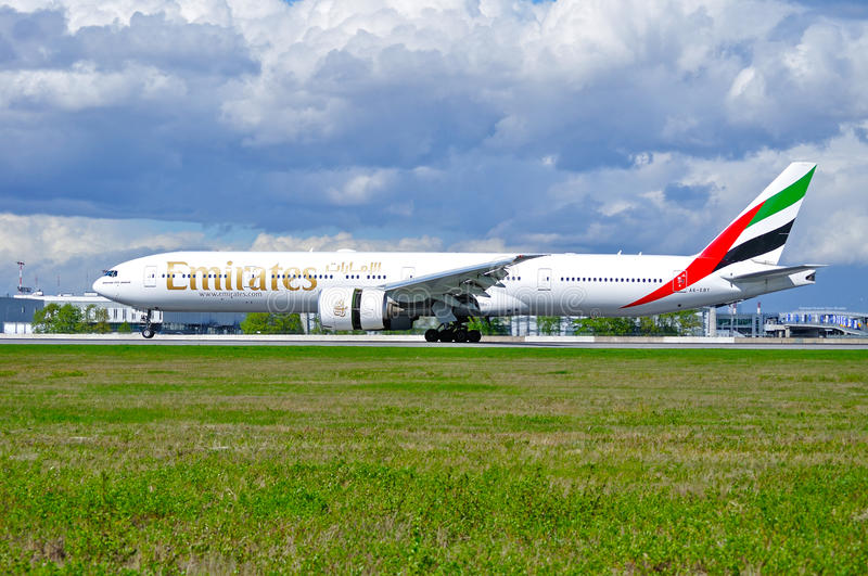Emirates Airline Boeing 777 aircraft is landing in Pulkovo International airport in Saint-Petersburg, Russia. ST PETERSBURG,RUSSIA-MAY 11,2016. A6-EBY Emirates royalty free stock image