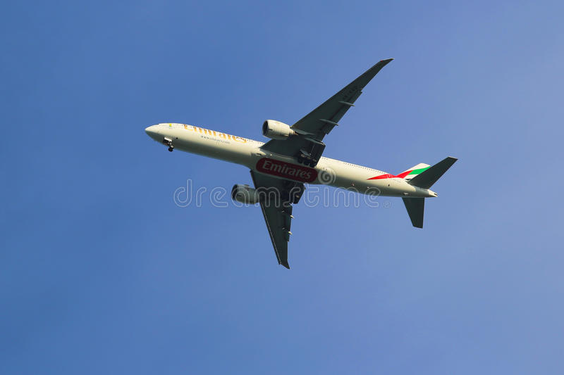 Emirates Airline Boeing 777 in New York sky before landing at JFK Airport. NEW YORK - JULY 6: Emirates Airline Boeing 777 in New York sky before landing at JFK stock images