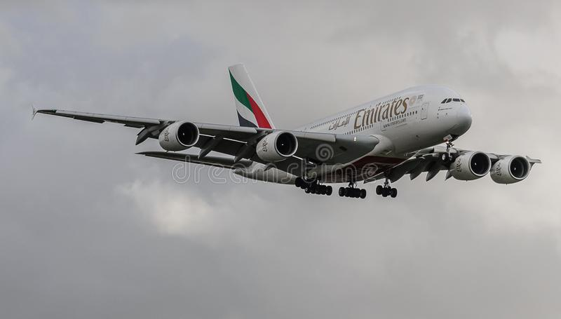 Emirates Airways A380 jet landing at Heathrow. Emirates Airways airbus A380 jet landing at Heathrow, october 2017 landing Gear down royalty free stock photography