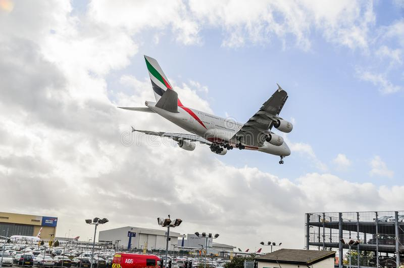Emirates Airways A380 jet landing at Heathrow. Emirates Airways airbus A380 jet landing at Heathrow, october 2017 landing Gear down royalty free stock images