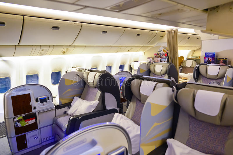 Emirates first class Boeing-777 interior. MOSCOW, RUSSIA - MARCH 30, 2015: Emirates first class Boeing-777 interior. Emirates is one of two flag carriers of the stock images