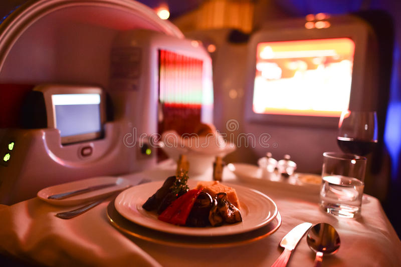 Emirates first class Boeing-777 interior. MOSCOW, RUSSIA - MARCH 30, 2015: Emirates first class Boeing-777 interior. Emirates is one of two flag carriers of the royalty free stock photos