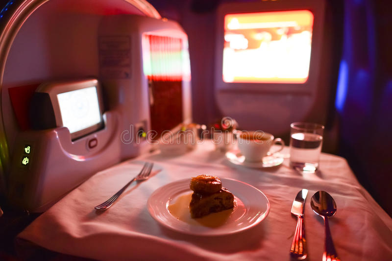 Emirates first class Boeing-777 interior. MOSCOW, RUSSIA - MARCH 30, 2015: Emirates first class Boeing-777 interior. Emirates is one of two flag carriers of the royalty free stock images